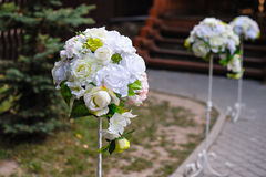 Beautiful white flower arrangements decorated the track for the. Wedding ceremony stock images