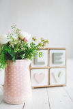 Beautiful white flowers in pot on wooden background Royalty Free Stock Photography