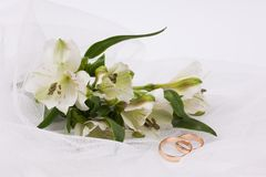 Beautiful white flowers  on a white veil Royalty Free Stock Photo