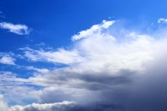 Beautiful white fluffy cloud formations on a blue sky taken in spring. Beautiful white fluffy cloud formations on a blue sky taken during spring royalty free stock image