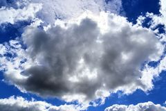 Beautiful white fluffy cloud formations on a blue sky taken in spring. Beautiful white fluffy cloud formations on a blue sky taken during spring royalty free stock photo