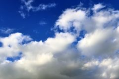 Beautiful white fluffy cloud formations on a blue sky taken in spring. Beautiful white fluffy cloud formations on a blue sky taken during spring stock photo