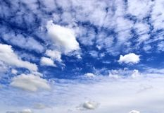Beautiful white fluffy cloud formations on a blue sky taken in spring. Beautiful white fluffy cloud formations on a blue sky taken during spring stock images