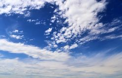 Beautiful white fluffy cloud formations on a deep blue sky royalty free stock image