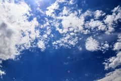 Beautiful white fluffy cloud formations on a deep blue sky stock images