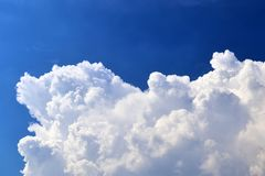 Beautiful white fluffy cloud formations on a deep blue sky stock photography