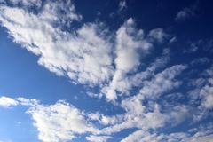 Beautiful white fluffy cloud formations on a deep blue sky royalty free stock photos