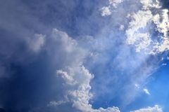 Beautiful white fluffy cloud formations on a deep blue sky royalty free stock images