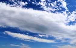 Beautiful white fluffy cloud formations on a deep blue sky stock image
