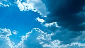 Beautiful white fluffy clouds in blue sky. Beautiful white fluffy clouds formation in a amazing blue sky background and clouds are backlit in sunshine stock photos