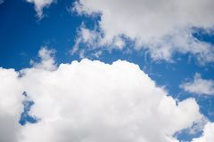 Beautiful white fluffy clouds on a blue sky background. Beautiful white fluffy clouds on a deep blue sky background. Scenic sky stock photos