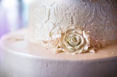 Beautiful White Fondant Lace Cake with Roses Royalty Free Stock Photography