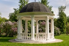 Beautiful white gazebo in a blooming spring Park.  Stock Photography