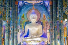Beautiful white giant Buddha image inside the Buddhist church at Wat Rong Suea Ten Temple, also known as the Blue Temple, locate a. T Chiang Rai province Stock Photography