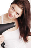 Beautiful white girl drying her hair with a hairdr Royalty Free Stock Images