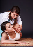 Beautiful white girl having Thai massage. Stock Images