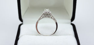 Beautiful White Gold One Carat Diamond Wedding Ring. This is a beautiful white gold one carat diamond wedding ring with intricate custom design on the band stock images