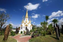 Beautiful white and gold pagoda architecture. Ornament: beautiful white and gold pagoda architecture against blue sky at wat Tham Kuha Sawan in Ubon Ratchathani Stock Photos