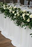 Beautiful White and Green Flower Decoration Arrangement on Wedding Table. Wedding Bridal Flower Decoration. Beautiful White and Green Flower Decoration stock photo