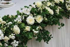 Beautiful White and Green Flower Decoration Arrangement on Wedding Table. Wedding Bridal Flower Decoration. Beautiful White and Green Flower Decoration royalty free stock photography