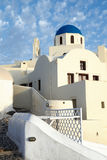 Beautiful white houses and local church with blue cupola in Oia Stock Image