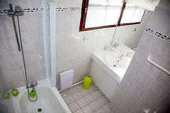 Beautiful white interior oof a bathroom in bright bathroom Stock Images