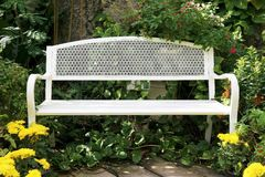 A Beautiful White Iron Bench in the Park. A Beautiful White Iron Bench in the City Park royalty free stock image