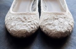 Beautiful white lace bridal shoes royalty free stock photo