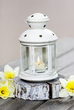 Beautiful white lantern with burning candle Royalty Free Stock Photo