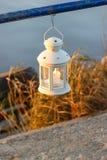 Beautiful white lantern hanging at the handrail Stock Photo