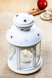 Beautiful white lantern on jute table cloth Stock Photo