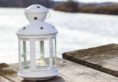 Beautiful white lantern at the wooden pier Stock Photo