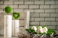 Beautiful white light Easter photo. Eggs of concrete lie in a wreath and moss. Concrete vases in the Loft style in the background. Revenge for your text Royalty Free Stock Photos