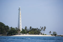 Beautiful white light house and blue sky, sea, with tropical plants Royalty Free Stock Images