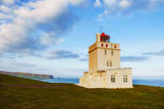 Beautiful white lighthouse at Cape Dyrholaey, South Iceland.  royalty free stock images