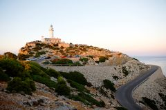 Beautiful white Lighthouse at Cape Formentor in the Coast of North Mallorca, Spain. Balearic Islands . Artistic sunrise. And dusk landascape royalty free stock image