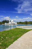 Beautiful white mosque with reflection in the lake during clean blue sky Royalty Free Stock Images