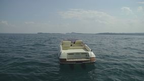 Beautiful white motorboat floating on lake Garda in Italy, journey, vacations. Stock footage stock video footage