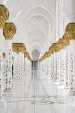 Beautiful white muslim churc interior, passageway. Abu-Dhabi Grand Moss, clean white pillars, and long pathway Stock Photos