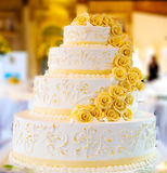 Wedding cake with roses. Beautiful white wedding cake with roses Royalty Free Stock Photo
