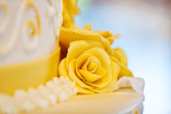 Wedding cake with roses stock image
