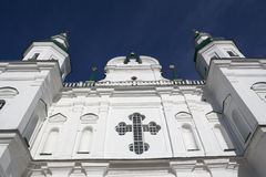 Beautiful white ortodox cathedral with crist. Beautiful white facade of ortodox cathedral with big window ortodox crist and white columns in Chernihiv Stock Photos