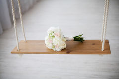 Beautiful white peony wedding bouquet on swing. Marriage concept Royalty Free Stock Image