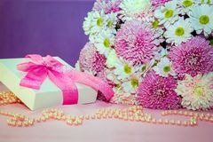 Romantic present concept - flowers and gift box Royalty Free Stock Photo