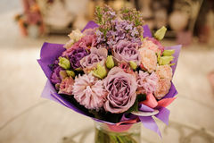 Beautiful white, pink, purple flower romantic bouquet. With bow Stock Image