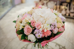 Beautiful white, pink, purple flower romantic bouquet. With bow Royalty Free Stock Image