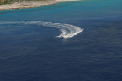 Beautiful White Pleasure Boat With Driver Leaving A Wide Wake In The Sea