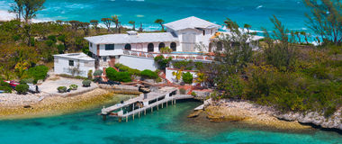 Beautiful white private house on the narrow shore. Crystal Cay. Nassau, Bahamas Royalty Free Stock Photography
