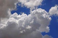 White puffy clouds in blue sky. Beautiful white puffy clouds in blue sky royalty free stock images