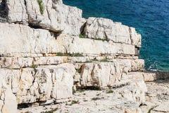 Beautiful white rock ocean coast as geology stone layers going i Stock Photos